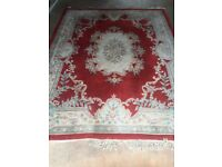 Large cream and red Chinese carpet