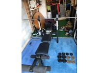 York Weight bench with barbell and weights