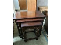 Nest of three dark oak tables by lock of London good condition