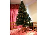 5ft Christmas tree. with fibre optics on the branches with base and transformer.