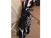 Wilson staff golf club bag and woodworm clubs