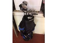 A full set of golf clubs including bag