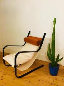 Ergonomically designed bespoke cantilevered armchair