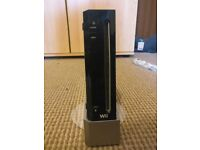 Nintendo Wii - Black. Good condition. Comes with 3 Games.