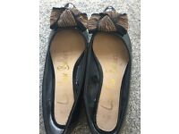Flat black shoes with gold bow size 4