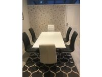 White high gloss extending dining table and six chairs