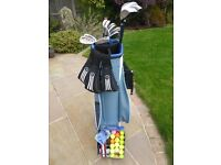 Ladies golf clubs with brand new Wilson bag, tees and balls