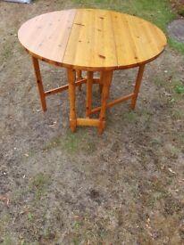 Folding round pine table