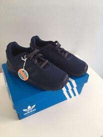 Child's size 9 Adidas trainers