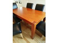 Solid wood dining table from next with 6 highback chairs in faux leather