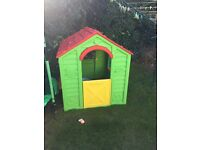children's playhouse and little tykes slide