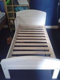 White wooden framed toddler bed