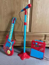 Carousel red rock star guitar with microphone and amp