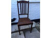 Two vintage oak chairs