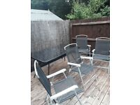 Patio table and 4 chairs with tarpaulin cover