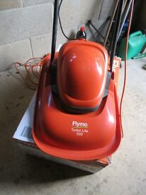 FLYMO TURBO LITE 330 .USED ONLY 6 TIMES . V.G .C.