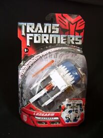 DELUXE TRANSFORMERS MOVIE AUTOBOT LONGARM NEW IN PACKAGING 2 IN 1 2007