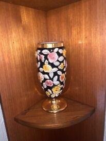 black flowery vase