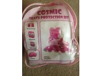 girls cosmic roller skates and protection set