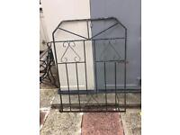 Two wrought iron gates and three hanging plant holders