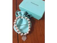 Genuine Tiffany bracelet and charm