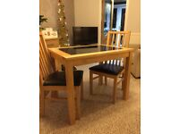 Dining table and 2 leather seated chairs - excellent condition.