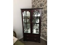 Bargain Display cabinet with mirror back two draws to base mahogany stain finish