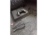 Brilliant condition 1TB PS4 with leads and controller