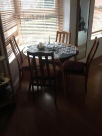 4 wooden chairs for quick sale!