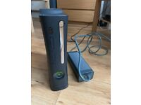 Xbox 360 with two controllers.
