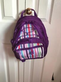 Small purple rucksack