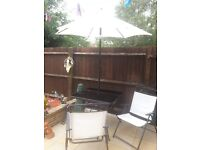 Cream patio table and 4 chairs