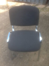 Black Stacking Chair in Used Condition