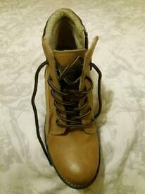 Never worn, fleeced lined, wedge boot