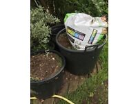Approximately 1/4 ton of garden soil, mostly bagged, a bag of sand, and various plastic plant pots