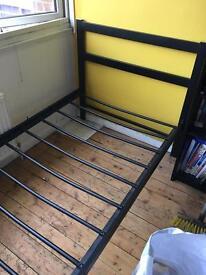 Single black metal bed