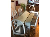 6 person Glass dining table and 6 wooden matching chairs