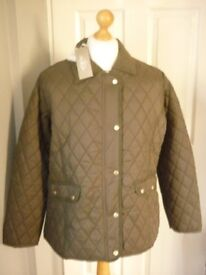 ladies quilted jacket,new with tags on,olive ,size 22.