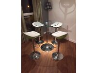 Glass High Top Table with 4 Matching Adjustable Bar Stools