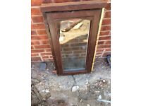 Brown Double glazed wooden window with trickle vent