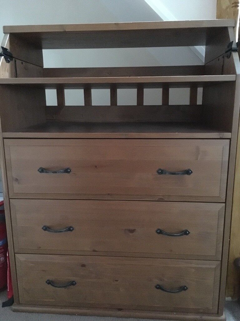 Baby changing table with drawers below
