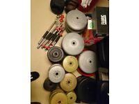 "York std folding bench ,1"" std vinyl weight plates 200kg plus and bars"