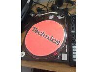 1x Technics SL-1210MK2 Turntable with Shure M447 Cartridge and stylus.
