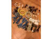 Various chargers, cables and earphones