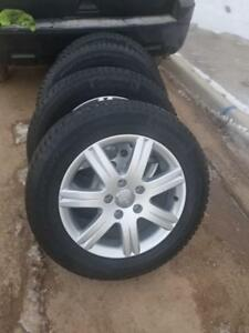 LIKE NEW AUDI Q7  ULTRA HIGH PERFORMANCE  CONTINENTAL 235 / 60  / 18  WINTER TIRES ON  AUDI OEM ALLOY WHEELS