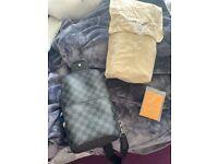 Men's Genuine Louis Vuitton damier print black sling bag.