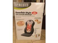 Homedics massager with heat. As new, and fits most chairs.