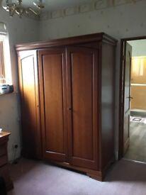 A large mahogany wardrobe