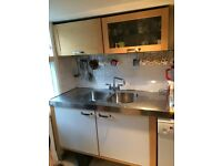 Nice free-standing kitchen for sale. Includes cabinets, sink and tap, dishwasher, fridge, cooker