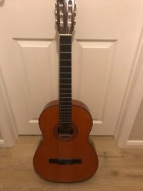 Acoustic guitar with left handed strings.